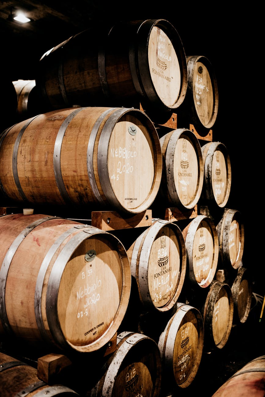 warehouse of wooden barrels with wine